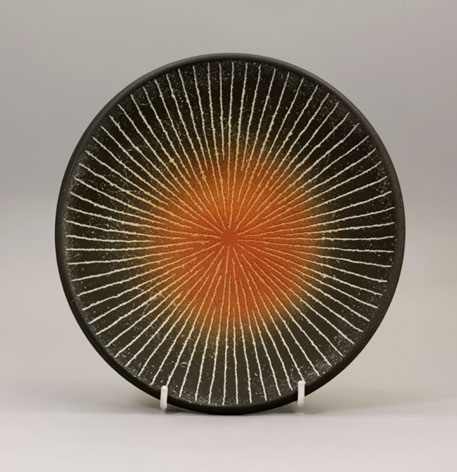 Ichino Masahiko - plate with geometric lines radiating from an orange circular centre