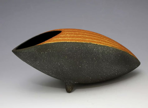 Ichino-Masahiko elliptical shaped vessel with pointed ends in orange and black
