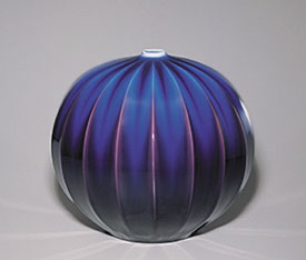spherical ceramic vessel in purple and blue by Tokuda Yasokichi III