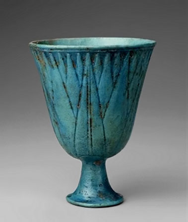 Egyptian footed blue vessel with lotus decoration