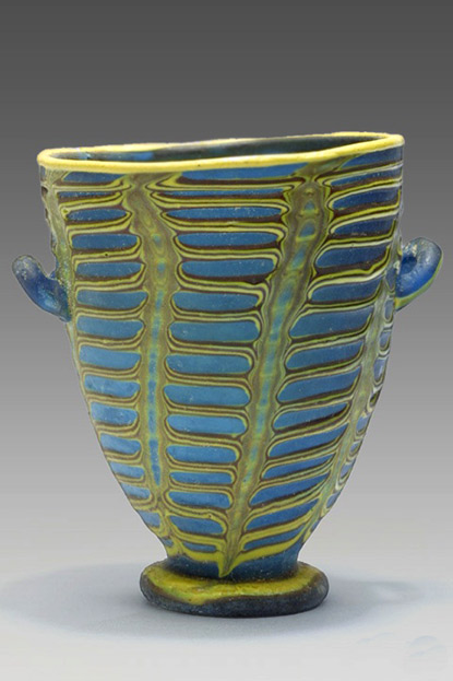 Polychrome glass cup with handles- Egyptian in blue with overlay yellow decoration