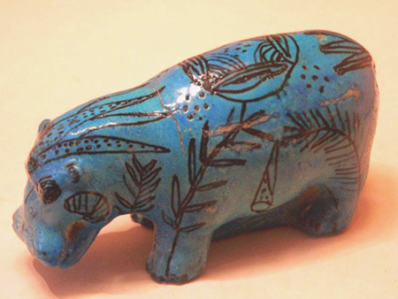 Egyptian blue faience-hippo figurine with surface decorations with Eye Of Horus