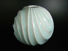 New Works by Ono Kotaro - spherical ceramic vase with wave pattern surface decoration