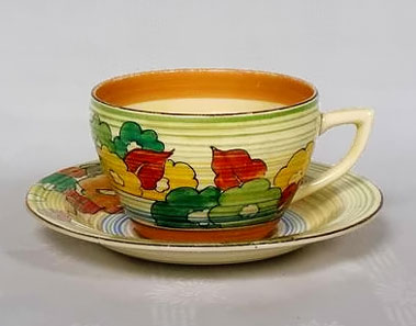 Clarice Cliff cup and saucer with floral decoration