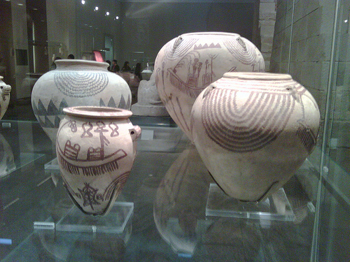 Four Egyptian pots with surface decorations