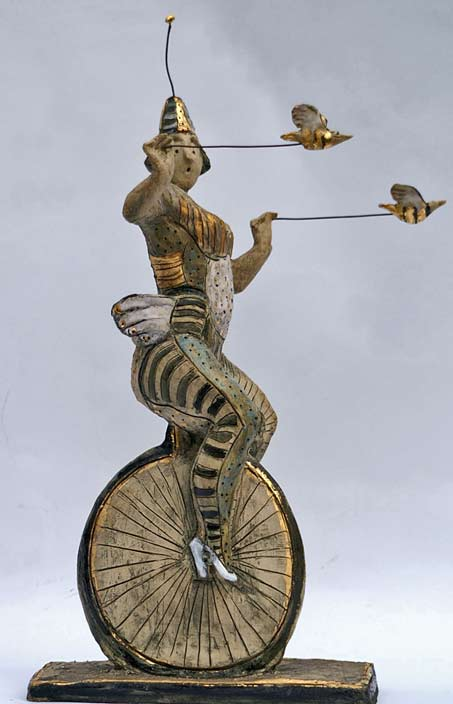 Ceramic-sculpture - Circus performer riding a monocycle by Hermien Buytendijk