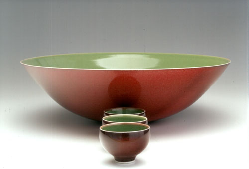 Porcelain bowl, Green celadon with red copper glaze by Phil Elson