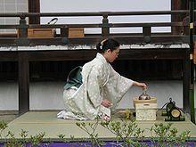 A Geisha girl performing a tea ceremony