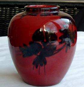 Willem Stuurman-dutch pottery crimson red ovoid vase with black floral motif