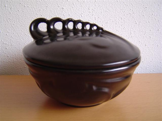 Black lidded vessel by Willem Stuurman