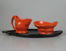 Willem Stuurman red jug and sugar bowl on a red tray