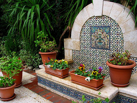 Garden courtyard with ceramic tiles and terracotta flower pots