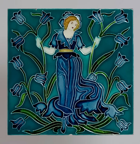 Art NOouveau tile with a girl in a blue gown by Walter Crane