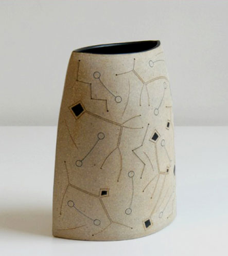 Gustavo Perez finely incised vase with abstract patterns