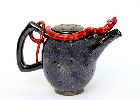 M Morigi 2012 black ceramic teapot with a red snake figurine on the edge