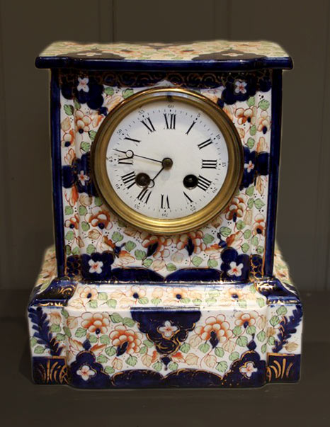 Antique French mantle clock with floral face