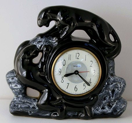 Snider clock lamp with two black panthers