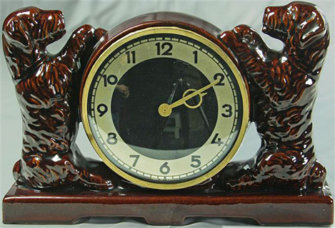 Vintage Ceramic Art Deco clock with two red puppies