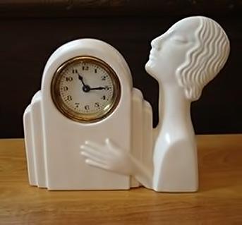 White ceramic figurine clock antiquarius-antiques