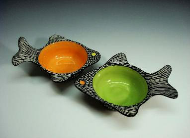 Shoshona Snow green and orange fish bowls