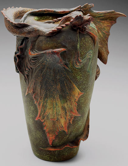 Amphora vase, designed by Eduard Stellmacher, large form with a sculpted dragon .