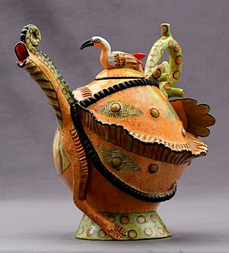 Chamelion Tea Pot by Ardmore in lime green and orange with a bird figure lid