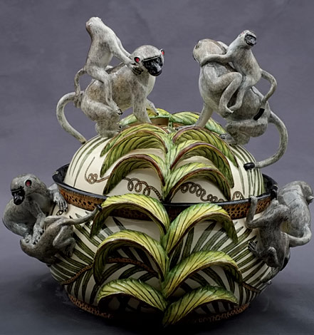 Ardmore-monkey tureen decorated with green leaves on cream, twin monkey lid and handles