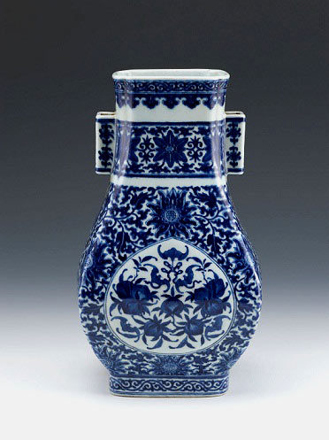 Qianlong rectangular baluster vase with tubular ears and 'happiness' and 'longevity' in underglaze blue