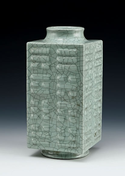 Qianlong square vase in a green celadon with ba qua symbpls