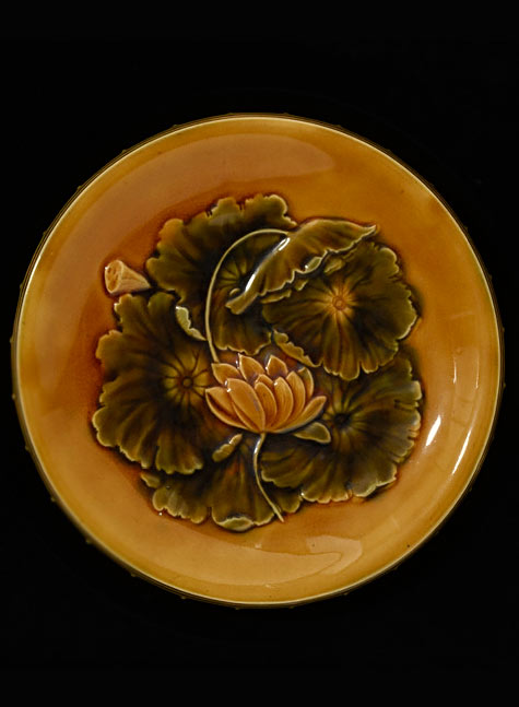 Lead-glazed earthenware dish . Design - C.Dresser