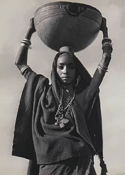 African fulani woman with large pot
