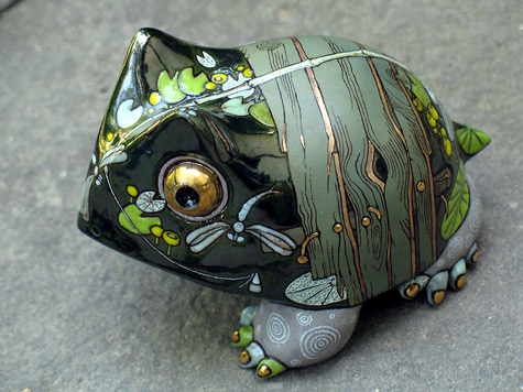 Small green frog with bridge drawn on shell by Anya Stasenko and Slava Leontiev