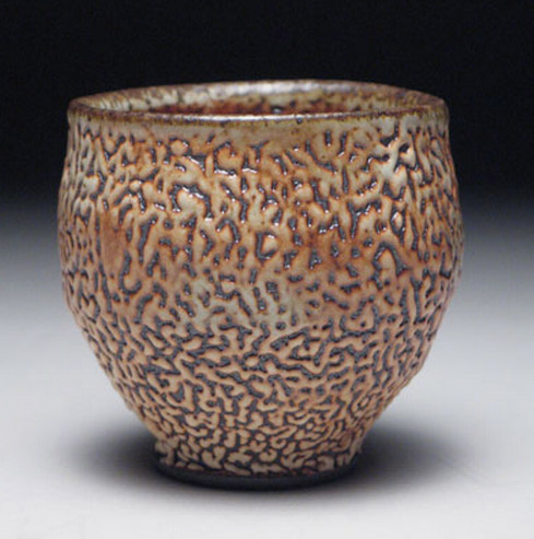 Stoneware teabowl with mottled surface by Matthew-Hyleck