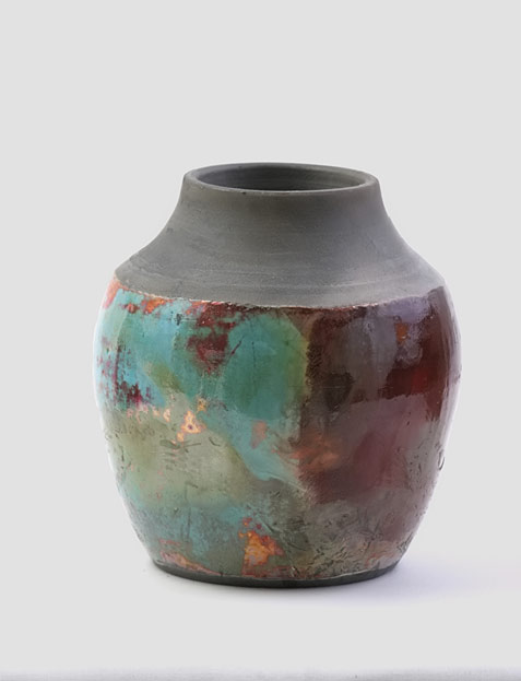 Green and maroon raku pottery vessel
