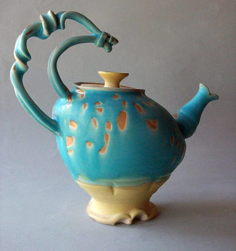 Turquoise glaze teapot with twisted handle