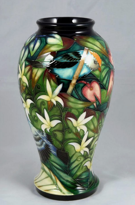 Moorcroft Chapada Sun Conure Vase with a bird in a tree with white flowers