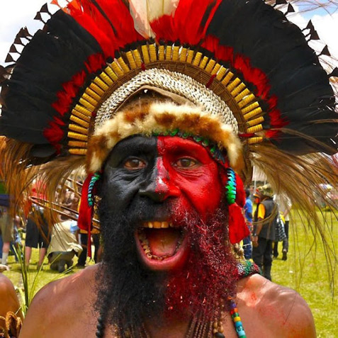 Papuan tribal face paint in red and black