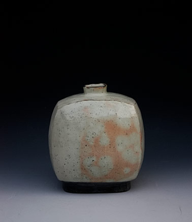 Lee Kang Hyo square bottle with rounded edges, orange on celedon glaze
