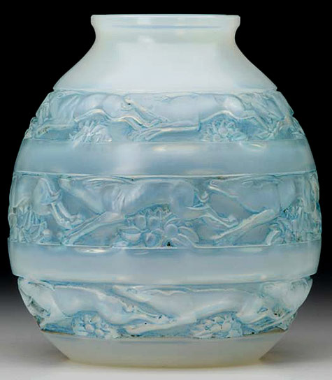Soudan vase of opalescent glass with blue patina with running gazelles