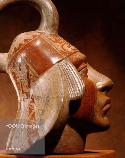 Stirrup-spouted-Mochica-portrait-jar-depicting-a-face-of-a-nobleman--600AD