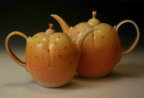 two teapots Pat Swyler - orange pumpkin style