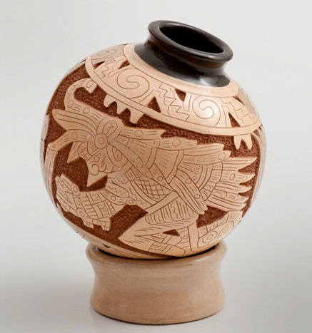 Peruvian ceramic vessel with carved decoartion