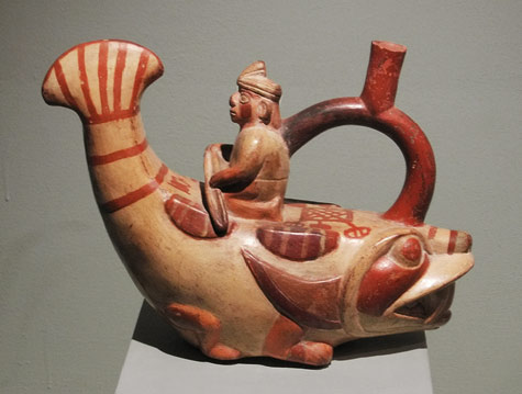 Moche sculptural stirrup spout bottle ;Peru with man on a fishes back