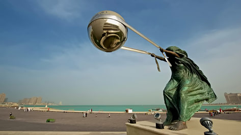 katara amphitheater sculpture of a man throwing a large sphere