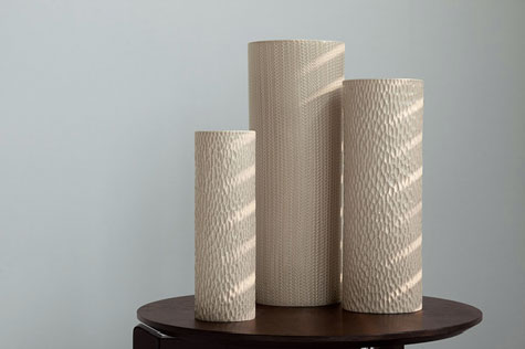 Three textured surface ceramic vases by Millie