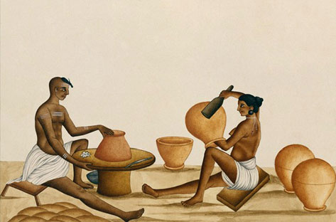 seated native potters making large pots