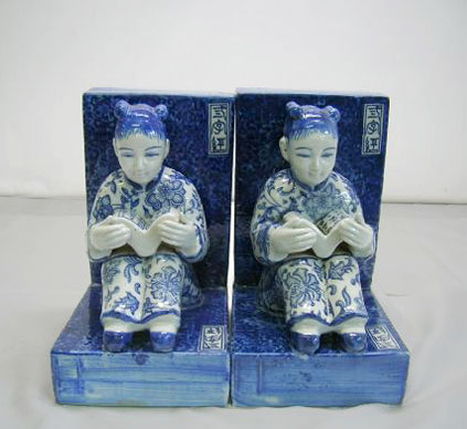 Pair of ceramic bookends with Chinese boy figures
