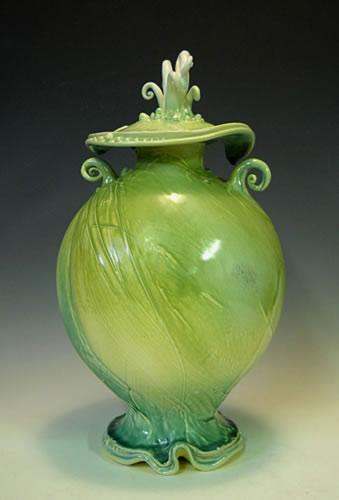 Lime green ovoid blossom Lidded Ceramic Jar on a wavy base - Carol Long