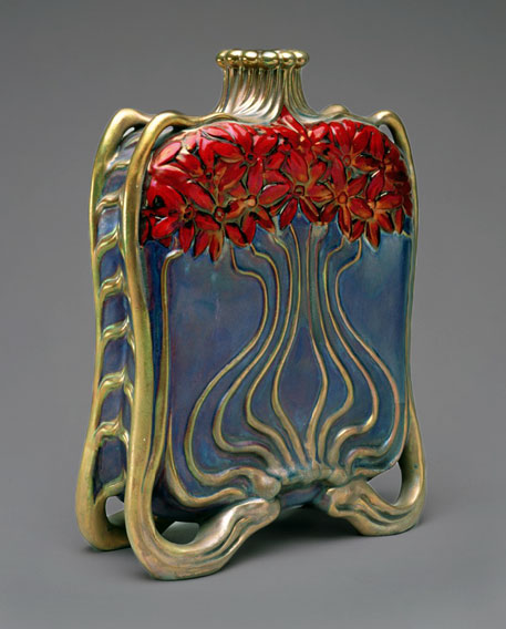 Art Nouveau bronze bottle with red flowers and undulating stems on a blue background