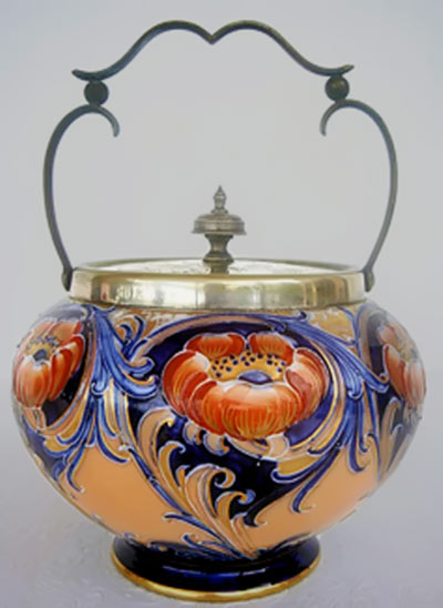 Moorcroft ceramic biscuit jar with brass metal lid and handle